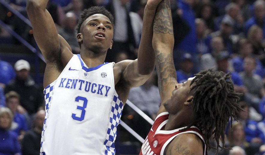 Kentucky's Hamidou Diallo (3) shoots while pressured by Alabama's John Petty during the first half of an NCAA college basketball game, Saturday, Feb. 16, 2018, in Lexington, Ky. (AP Photo/James Crisp)