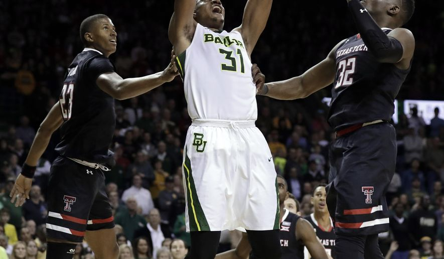 Texas Tech's Jarrett Culver (23) and Norense Odiase (32) defend as Baylor forward Terry Maston (31) dunks in the second half of an NCAA college basketball game Saturday, Feb. 17, 2018, in Waco, Texas. (AP Photo/Tony Gutierrez)