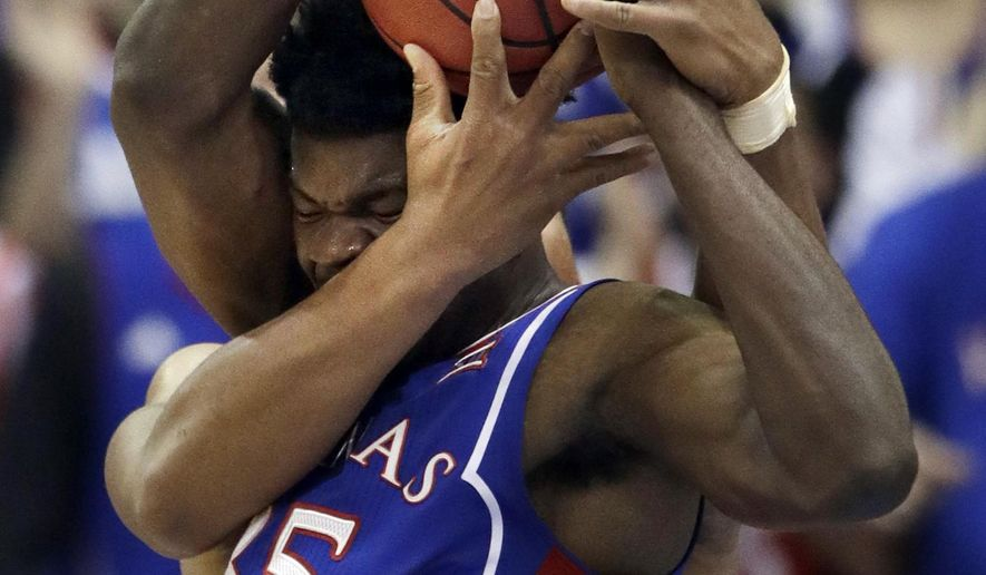 Kansas center Udoka Azubuike (35) rebounds against West Virginia forward Sagaba Konate, back, during the first half of an NCAA college basketball game in Lawrence, Kan., Saturday, Feb. 17, 2018. (AP Photo/Orlin Wagner)