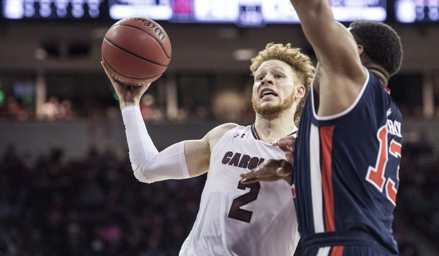 South Carolina guard Hassani Gravett (2) drives to the hoop against Auburn forward Desean Murray (13) during the first half of an NCAA college basketball game Saturday, Feb. 17, 2018, in Columbia, S.C. (AP Photo/Sean Rayford)