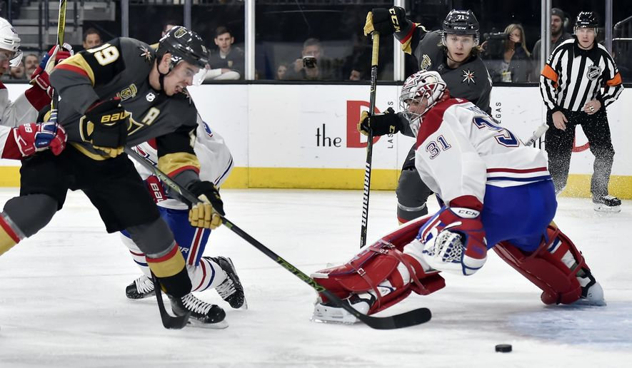 Vegas Golden Knights right wing Reilly Smith (19) shoots for a goal against Montreal Canadiens goaltender Carey Price during the second period of an NHL hockey game Saturday, Feb. 17, 2018, in Las Vegas. (AP Photo/David Becker)
