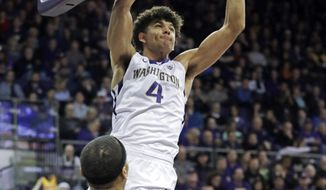Washington's Matisse Thybulle (4) dunks against Colorado during the second half of an NCAA college basketball game Saturday, Feb. 17, 2018, in Seattle. Washington won 82-59. (AP Photo/Elaine Thompson)