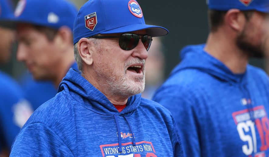 Chicago Cubs manager Joe Maddon walks out from the clubhouse at the team's spring training baseball facility Friday, Feb. 16, 2018, in Mesa, Ariz. (AP Photo/Carlos Osorio)