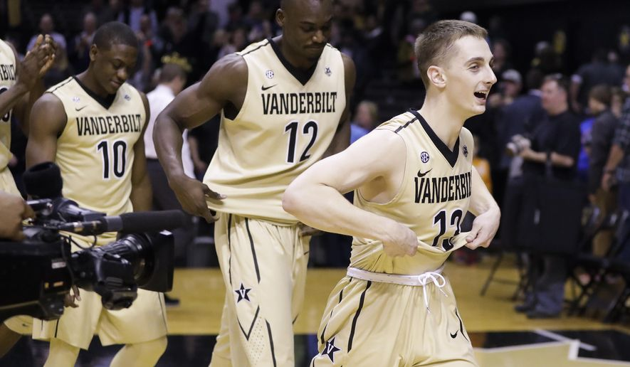 Vanderbilt's Riley LaChance (13), Djery Baptiste (12) and Maxwell Evans (10) leave the court after beating Florida in an NCAA college basketball game Saturday, Feb. 17, 2018, in Nashville, Tenn. Vanderbilt won 71-68. (AP Photo/Mark Humphrey)