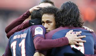 PSG's Neymar hugs teammates after Angel Di Maria scores a goal against Strasbourg during the French League One soccer match between Paris Saint Germain and Strasbourg, at the Parc des Princes stadium in Paris, France, Saturday, Feb. 17, 2018. (AP Photo/Francois Mori)