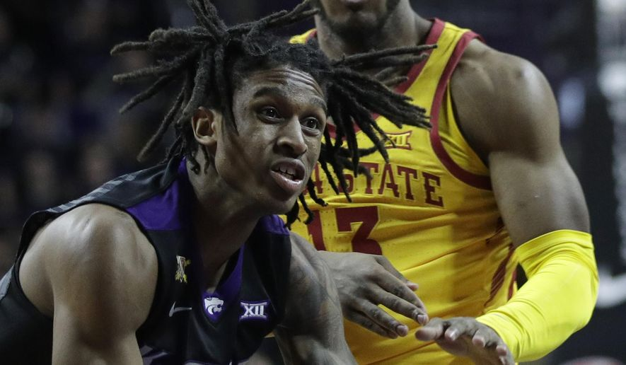 Kansas State guard Cartier Diarra (2) drives on Iowa State guard Jakolby Long (13) during the second half of an NCAA college basketball game in Manhattan, Kan., Saturday, Feb. 17, 2018. (AP Photo/Orlin Wagner)