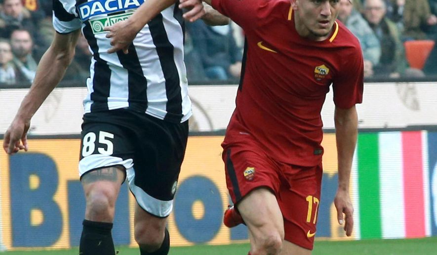 Udinese's Valon Behrami, left, and Roma's Cenzig Under, vie for the ball during the Italian Serie A soccer match between Udinese and Roma at the Friuli stadium in Udine, Italy, Saturday, Feb. 17, 2018. (Stefano Lancia/ANSA via AP)
