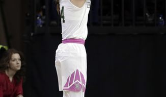 Baylor guard Kristy Wallace (4) of Australia shoots a three-point basket in the first half of an NCAA college basketball game against Kansas on Saturday, Feb. 17, 2018, in Waco, Texas. Wallace sunk the basket and four more three-pointers, leading all scoring with 26 points in the 88-51 Baylor win. (AP Photo/Tony Gutierrez)