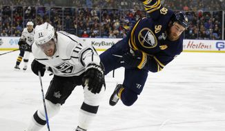 Buffalo Sabres Ryan O'Reilly (90) and Los Angeles Kings Anze Kopitar (11) skate into the corner during the second period of an NHL hockey game, Saturday, Feb. 17, 2018, in Buffalo, N.Y. (AP Photo/Jeffrey T. Barnes)