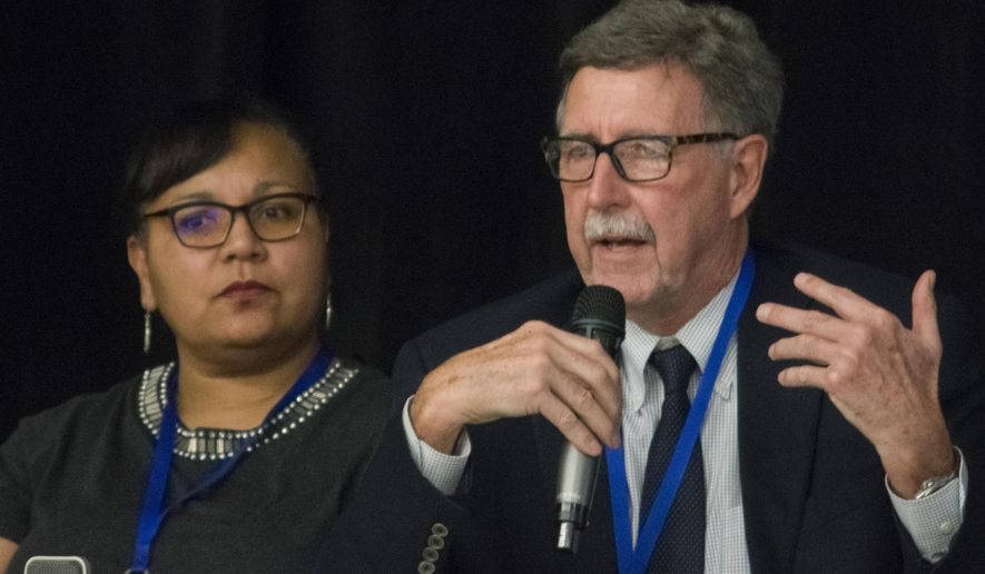 In this photo taken Feb. 13, 2018, Rick Harris, right, senior research fellow for the Sealaska Heritage Institute, speaks at the Southeast Conference's Mid-Session Summit in Juneau, Alaska. Watching the Winter Olympics this past week, Harris saw something that surprised him. The Canadian snowboarding team was on screen, wearing jackets that carried designs inspired by Tlingit and Kwakiutl artwork. Harris knows native art of the Northwest is not only culturally valuable, but it is also popular and could be an economic driver for Southeast Alaska. (Richard McGrail/Juneau Empire via AP)