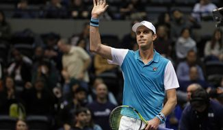 Sam Querrey celebrates after defeating Adrian Mannarino, of France, in their semifinals match at the New York Open tennis tournament in Uniondale, N.Y., on Saturday, Feb. 17, 2018. (AP Photo/Adam Hunger)