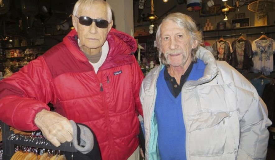 This Jan. 18, 2013 photo provided by Ron Gomez shows legendary climbers Layton Kor, left, and Jim Bridwell in Kingman, Ariz. Bridwell, a hard-partying hippie and legendary climber who lived his life vertically on some of the toughest peaks in Yosemite National Park, has died at age 73. Bridwell died Friday, Feb. 16, 2018, at a hospital. He had liver and kidney failure from hepatitis C that he may have contracted in the 1980s when he got a tattoo from a headhunting tribe in Borneo, his wife, Peggy Bridwell of Palm Desert, told The Associated Press on Saturday.  (Ron Gomez via AP)