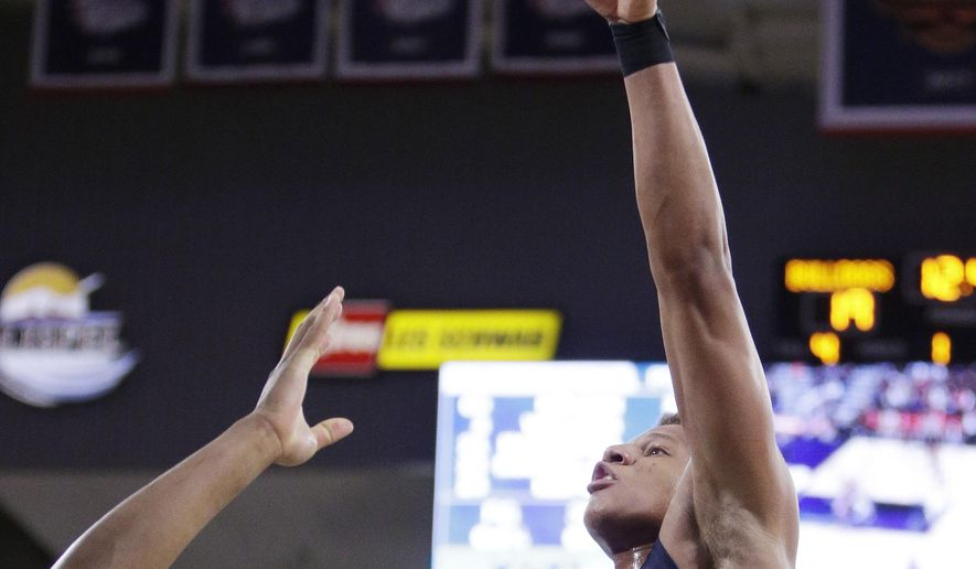 Pepperdine forward Kameron Edwards (20) shoots over Gonzaga forward Rui Hachimura during the first half of an NCAA college basketball game in Spokane, Wash., Saturday, Feb. 17, 2018. (AP Photo/Young Kwak)