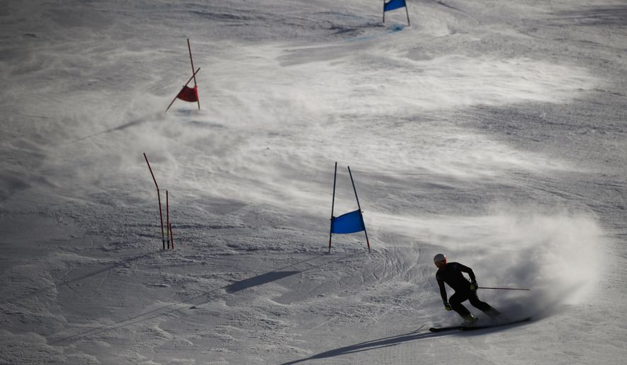 An athlete trains at the Yongpyong Alpine Center at the 2018 Winter Olympics in Pyeongchang, South Korea, Friday, Feb. 16, 2018. (AP Photo/Jae C. Hong)