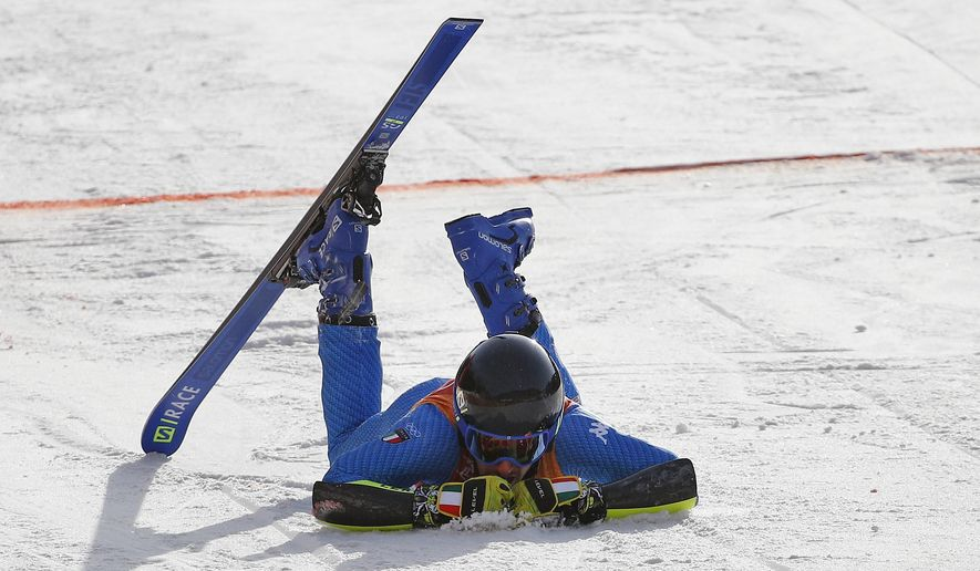 Italy's Aliprandini Luca De Aliprandini lies in the finish area after crashing during the first run of the men's giant slalom at the 2018 Winter Olympics in Pyeongchang, South Korea, Sunday, Feb. 18, 2018. (AP Photo/Christophe Ena)
