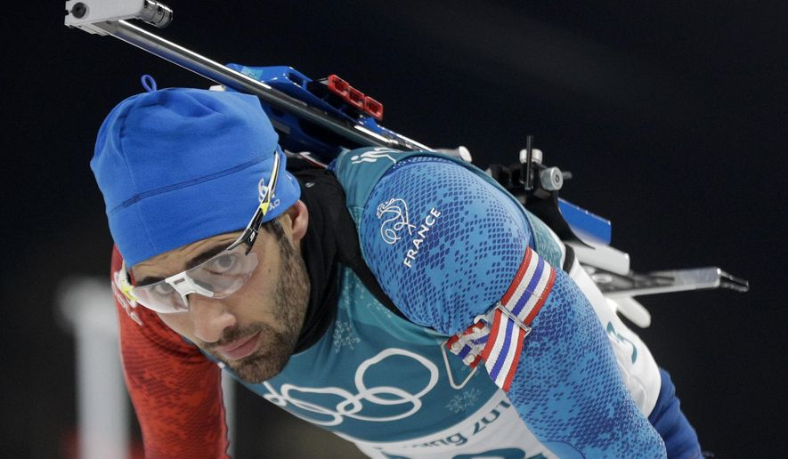 Martin Fourcade, of France, rests in the finish area after the men's 20-kilometer individual biathlon at the 2018 Winter Olympics in Pyeongchang, South Korea, Thursday, Feb. 15, 2018. (AP Photo/Gregorio Borgia)