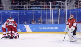 Goalie Florence Schelling (41), of Switzerland, reacts as the Olympic Athletes from Russia team celebrates a goal by Viktoria Kulishova (73) during the second period of the quarterfinal round of the women's hockey game at the 2018 Winter Olympics in Gangneung, South Korea, Saturday, Feb. 17, 2018. (AP Photo/Frank Franklin II)