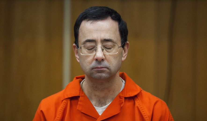FILE - In this Feb. 5, 2018, file photo, Larry Nassar listens during his sentencing at Eaton County Circuit Court in Charlotte, Mich. Right in the midst of the Pyeongchang Games, with hardly enough time for Larry Nassar to settle into the prison cell where he'll be spending the rest of his life, we got another report detailing horrific abuse and shameful cover-ups within one of the most high-profile summer sports. (Cory Morse/The Grand Rapids Press via AP, File)