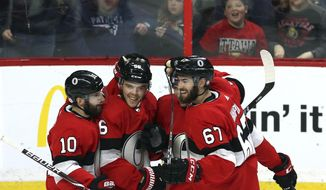 Ottawa Senators left wing Magnus Paajarvi (56) celebrates his goal against the New York Rangers with defenseman Ben Harpur (67), defenseman Cody Ceci (5) and left wing Tom Pyatt (10) during third-period NHL hockey game action in Ottawa, Ontario, Saturday, Feb. 17, 2018. (Fred Chartrand/The Canadian Press via AP)
