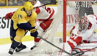 Detroit Red Wings goaltender Petr Mrazek (34), of the Czech Republic, blocks a shot by Nashville Predators right wing Craig Smith (15) in the second period of an NHL hockey game Saturday, Feb. 17, 2018, in Nashville, Tenn. (AP Photo/Mark Humphrey)