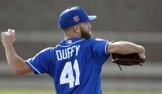 Kansas City Royals pitcher Danny Duffy throws during a baseball spring training workout, Saturday, Feb. 17, 2018, in Surprise, Ariz. (AP Photo/Charlie Neibergall)