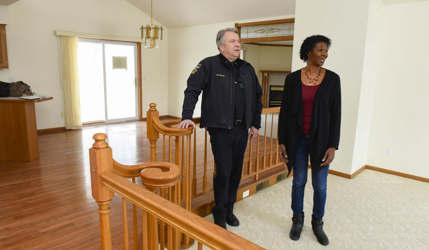 Waite Park Police Chief Dave Bentrud and CeCe Terlouw, executive director of Terebinth Refuge, tour a home Monday, Feb. 12, 2018, that will be the new shelter and transitional housing for victims of sex trafficking in Waite Park, Minn. (Jason Wachter/St. Cloud Times via AP)