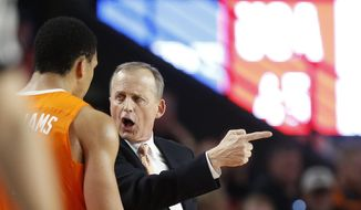 Tennessee coach Rick Barnes specks with forward Grant Williams (2) during the second half of an NCAA college basketball game against Georgia in Athens, Ga., Saturday, Feb. 17, 2018. (Joshua L. Jones/Athens Banner-Herald via AP)
