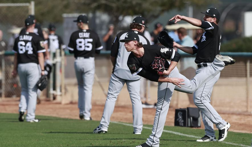 Chicago White Sox pitcher Michael Kopech participates in a drill at the team's spring training baseball facility Saturday, Feb. 17, 2018, in Glendale, Ariz. (AP Photo/Carlos Osorio)