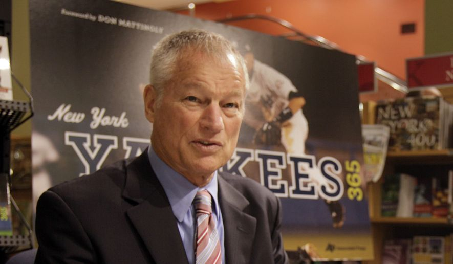 """Former New York Yankees pitcher Jim Bouton signs copies of the Associated Press book """"New York Yankees 365,"""" in New York,  Wednesday, Oct. 7, 2009. The Associated Press, founded in 1846, the same year as the first recorded baseball game was played in Hoboken, N.J., has published a new book chronicling the history of the sport's winningest team, the New York Yankees. (AP Photo/Richard Drew)"""