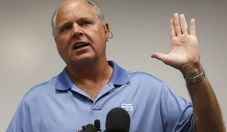 """FILE - In this Jan. 1, 2010 file photo, conservative talk show host Rush Limbaugh speaks during a news conference at The Queen's Medical Center in Honolulu. Advertisers and some radio stations may have abandoned Limbaugh for calling a Georgetown law student a """"slut."""" But the CEO of the radio company that distributes Limbaugh's show, Clear Channel, says he's sticking with the conservative talk show host, calling him the """"king"""" of radio.  (AP Photo/Chris Carlson, File)"""
