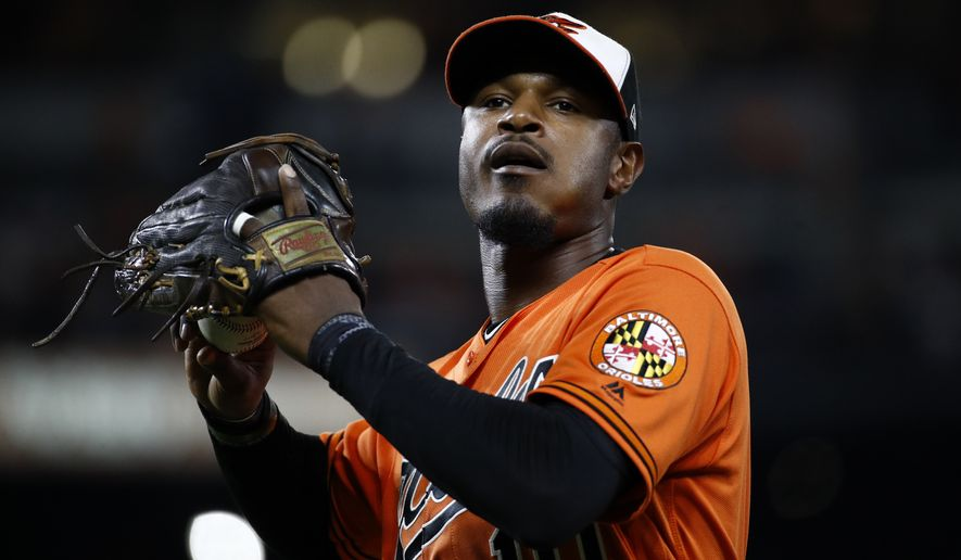 Baltimore Orioles center fielder Adam Jones tosses a ball to fans as he walks off the field between innings of a baseball game against the Tampa Bay Rays in Baltimore, Saturday, Sept. 23, 2017. (AP Photo/Patrick Semansky)