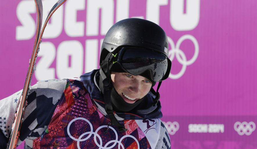 Gus Kenworthy of the United States reacts after his first run  in the men's ski slopestyle final at the Rosa Khutor Extreme Park, at the 2014 Winter Olympics, Thursday, Feb. 13, 2014, in Krasnaya Polyana, Russia. (AP Photo/Gero Breloer)