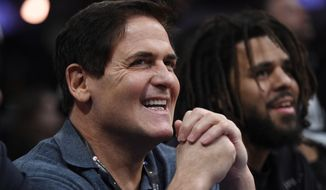 Dallas Mavericks owner Mark Cuban looks on from the crowd during NBA All-Star Saturday on Saturday, Feb. 17, 2018, in Los Angeles. (AP Photo/Chris Pizzello) **File**