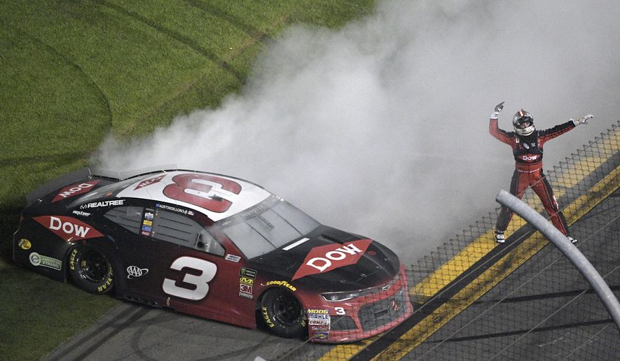Austin Dillon (3) celebrates on the track after winning the NASCAR Daytona 500 auto race at Daytona International Speedway Sunday, Feb. 18, 2018, in Daytona Beach, Fla. (AP Photo/Phelan M. Ebenhack)