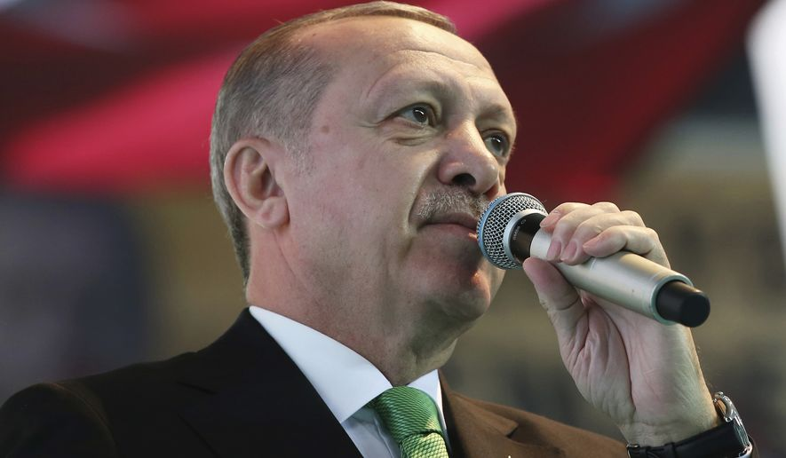 "President Recep Tayyip Erdogan told the Turkish parliament recently that American forces in Syria should prepare for an ""Ottoman slap."" (Associated Press/File)"