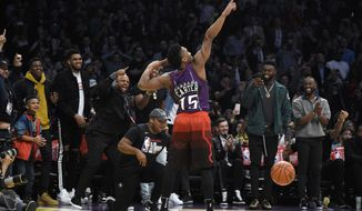 Utah Jazz's Donovan Mitchell gestures after dunking during the NBA All-Star basketball Slam Dunk contest, Saturday, Feb. 17, 2018, in Los Angeles. Mitchell won the event. (AP Photo/Chris Pizzello)
