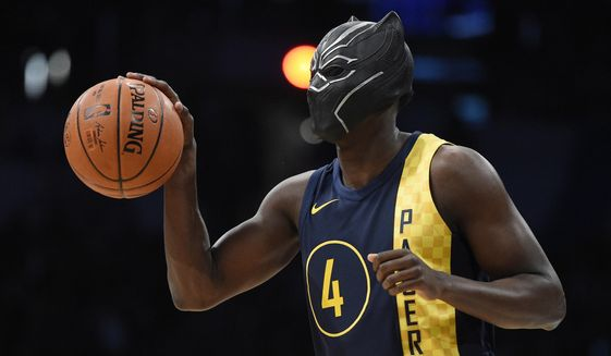 "Indiana Pacers' Victor Oladipo gets ready for a dunk while wearing a mask from the movie ""Black Panther"" during the NBA All-Star basketball slam dunk contest Saturday, Feb. 17, 2018, in Los Angeles. (AP Photo/Chris Pizzello)"