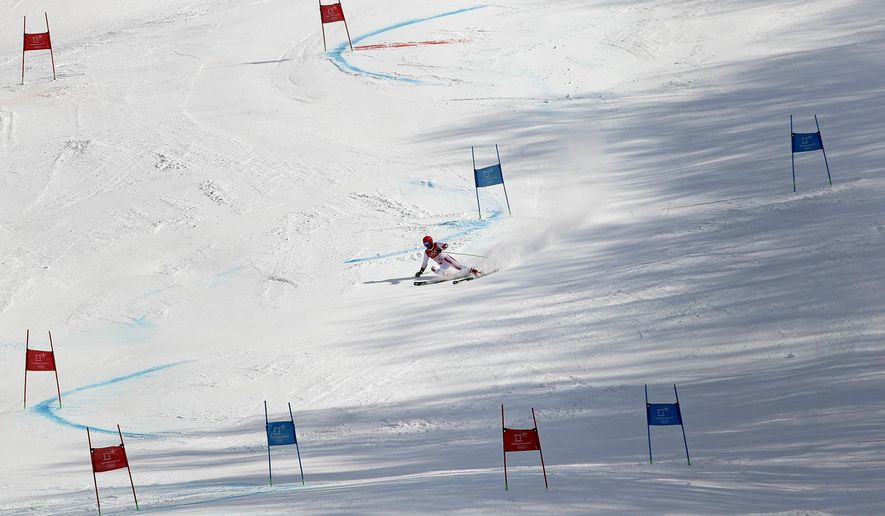 Austria's Marcel Hirscher skis to the gold medal following the second run of the men's giant slalom at the 2018 Winter Olympics in Pyeongchang, South Korea, Sunday, Feb. 18, 2018. (AP Photo/Christophe Ena)