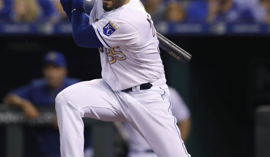 FILE - In a Friday, Sept. 29, 2017 file photo, Kansas City Royals' Eric Hosmer hits an RBI-single in the first inning of a baseball game against the Arizona Diamondbacks at Kauffman Stadium in Kansas City, Mo. A person with direct knowledge of the deal said Sunday, Feb. 18, 2018 that free agent first baseman Hosmer has reached preliminary agreement on an eight-year contract with the San Diego Padres, pending a physical.  (AP Photo/Colin E. Braley, File)
