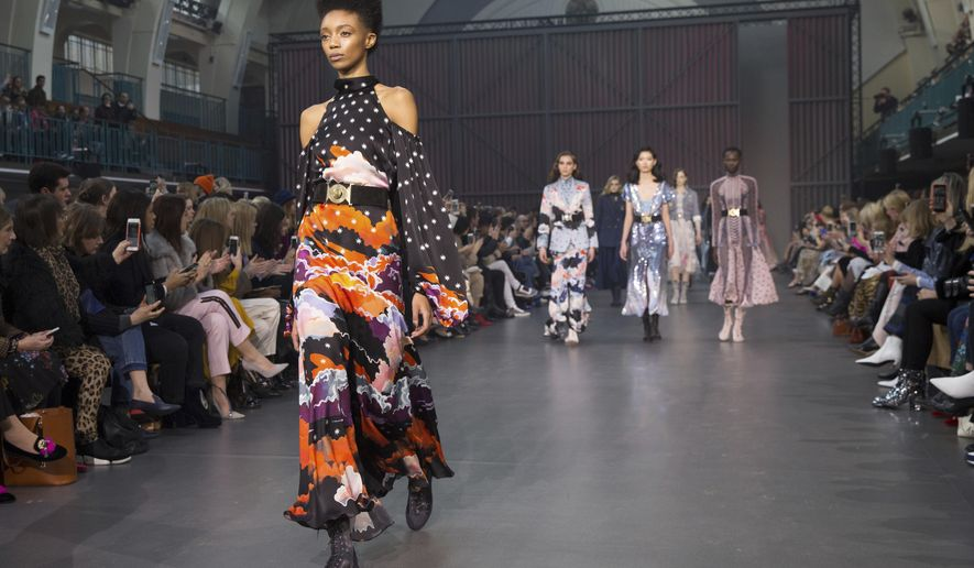 Models wear creations by Temperley at the Autumn/Winter 2018 runway show in London, Sunday, Feb. 18, 2018. (Photo by Grant Pollard/Invision/AP)