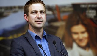 FILE - In this Wednesday, June 22, 2016 file photo, Brendan Cox, widower of murdered British MP Jo Cox makes a speech during a gathering to celebrate her life, in Trafalgar Square, London. The widower of a slain British legislator stepped down from two charities on Saturday Feb. 18, 2018, set up in her memory after allegations of sexual misconduct in the past were reported. (AP Photo/Alastair Grant, File)