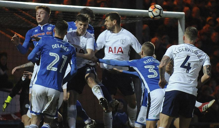 Rochdale's Mark Kitching, second from right, heads the ball during the English FA Cup fifth round soccer match between Rochdale AFC and Tottenham Hotspur at the Crown Oil Arena in Rochdale, England, Sunday, Feb. 18, 2018. (AP Photo/Rui Vieira)