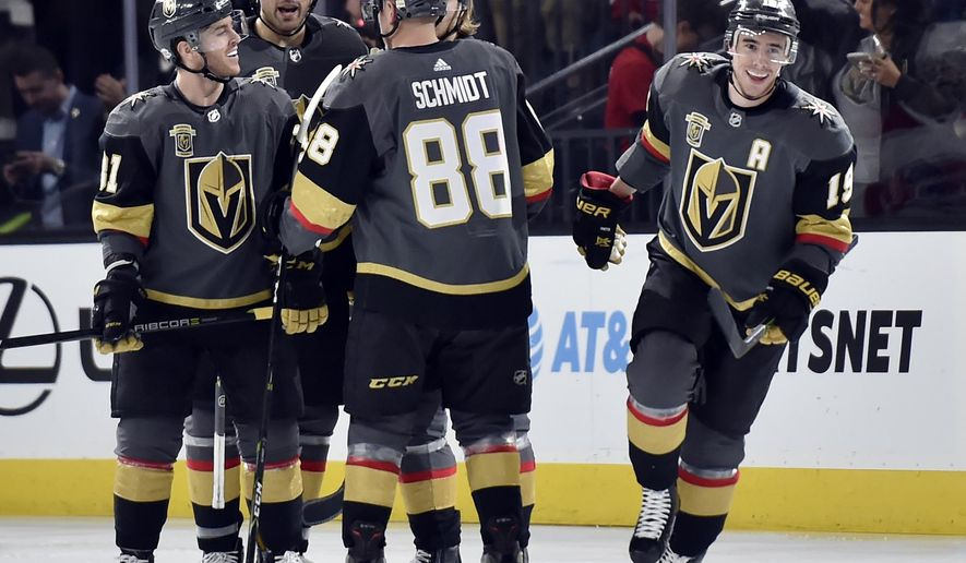 Vegas Golden Knights right wing Reilly Smith (19) celebrates with his team after scoring the first of his two goals during an NHL hockey game against the Montreal Canadiens, Saturday, Feb. 17, 2018, in Las Vegas. (AP Photo/David Becker)