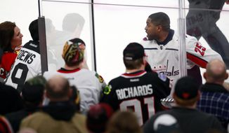 Washington Capitals right wing Devante Smith-Pelly (25) argues with Chicago Blackhawks fans from the penalty box during the third period of an NHL hockey game Saturday, Feb. 17, 2018, in Chicago. The Blackhawks won 7-1. (AP Photo/Jeff Haynes) **FILE**
