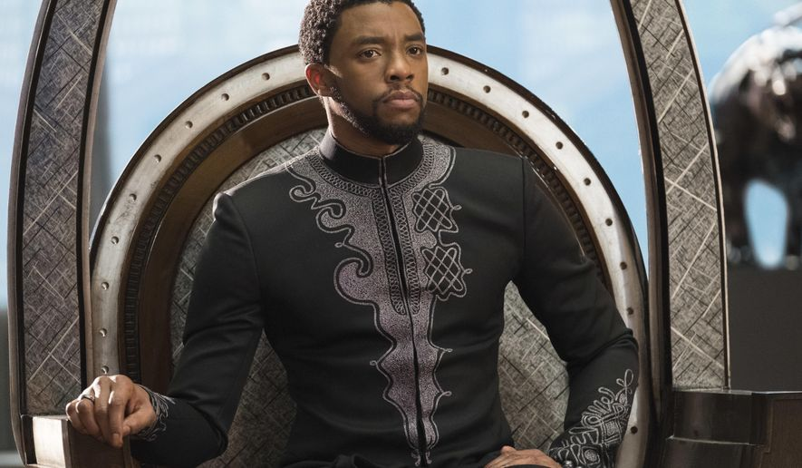 "This image released by Disney shows Chadwick Boseman in a scene from Marvel Studios' ""Black Panther.""    The Walt Disney Co. estimated Saturday, Feb. 17, 2018,  the Marvel Comics superhero movie earned $75.8 million domestically for its opening Friday, the eighth biggest day in industry history. (Matt Kennedy/Marvel Studios-Disney via AP)"