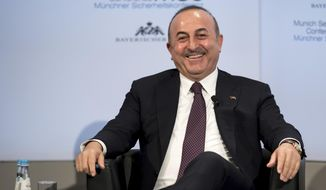 Turkey's Foreign Minister Mevlut Cavusoglu attends a panel discussion during the International Security Conference in Munich, Germany, Sunday, Feb. 18, 2018. (Sven Hoppe/dpa via AP) ** FILE **