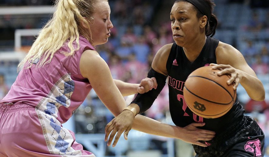 North Carolina's Taylor Koenen guards Louisville's Asia Durr during the first half of an NCAA college basketball game in Chapel Hill, N.C., Sunday, Feb. 18, 2018. (AP Photo/Gerry Broome)