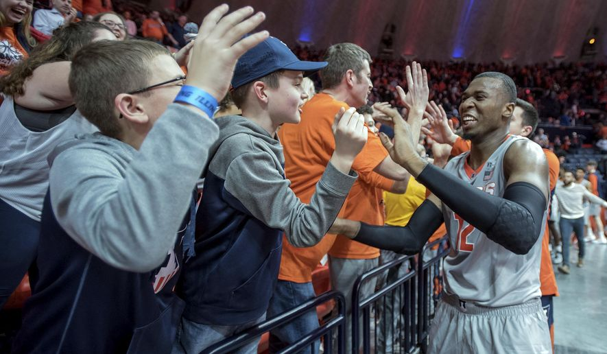 Illinois forward Leron Black (12) greets fans during the second half of an NCAA college basketball game in Champaign, Ill., on Sunday, Feb. 18, 2018. Illinois won 72-66. (AP Photo/Rick Danzl)