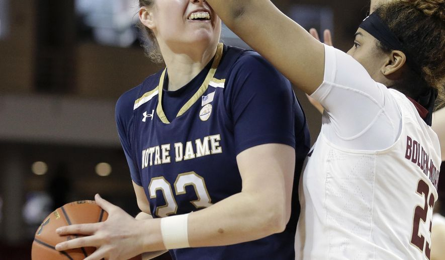 Notre Dame forward Jessica Shepard, left, tries to drive past Boston College guard Milan Bolden-Morris, right, in the second half of an NCAA college basketball game, Sunday, Feb. 18, 2018, in Boston. (AP Photo/Steven Senne)