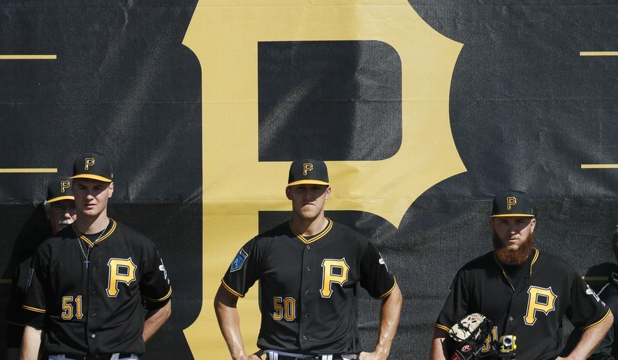 Pittsburgh Pirates pitchers Jordan Milbrath (51), Jameson Taillon (50), and A.J. Schugel, right, stand in the bullpen during baseball spring training Friday, Feb. 16, 2018, in Bradenton, Fla. (AP Photo/John Minchillo)